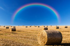 Straw bales and rainbow Stock Images