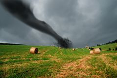 Straw bales into the storm. With tornado Stock Photo