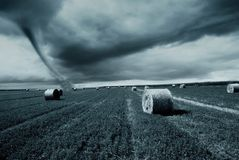 Straw bales under cloudy sky Royalty Free Stock Photography