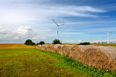 Straw bales and wind turbines Royalty Free Stock Photography