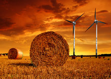 Straw bales with wind turbines Stock Photography