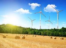 Straw bales with wind turbines Stock Images