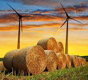 Straw bales with wind turbines Royalty Free Stock Images