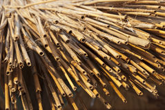 Straw and bamboo bunch Stock Photography