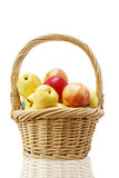 Straw basket with apples Royalty Free Stock Image