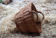 Straw wicker basket on hay Stock Photo
