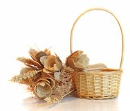 Straw basket and flowers Stock Photo