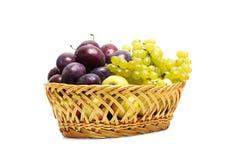 Straw basket of fruit Stock Photography