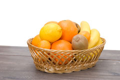 Straw basket with fruits Stock Photography