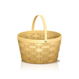Straw basket with a handle and reflection Royalty Free Stock Images