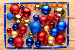 Straw basket packed full of multi-colored Christmas balls stock images