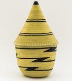 Straw Basket. Rwandan woven straw peace basket on white Royalty Free Stock Images