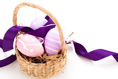 Straw basket with traditional Easter eggs Royalty Free Stock Photos