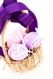 Straw basket with traditional Easter eggs Stock Photos