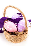 Straw basket with traditional Easter eggs Royalty Free Stock Photo