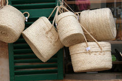 Straw baskets. A few straw baskets hanging outside a store or shop Royalty Free Stock Photography