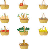 Straw baskets. Ten baskets with fruit and vegetables Royalty Free Stock Photo