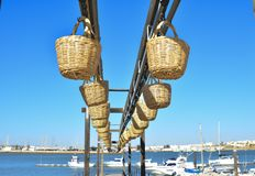 Straw baskets for transporting fish from the ocean to the shore Stock Photography