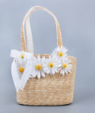 Straw beach bag with flowers Stock Image