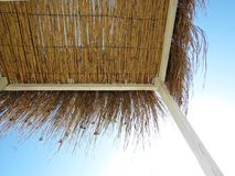 Straw Beach Roof Protecting from Sun During Exotic Vacation royalty free stock image