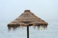 Straw beach umbrella Stock Image