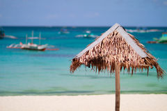 Straw beach umbrella Royalty Free Stock Photos