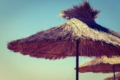 Straw beach umbrella Royalty Free Stock Image