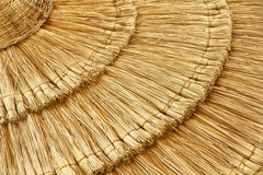 Straw beach umbrella close-up Stock Images