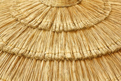 Straw beach umbrella close-up Stock Photography