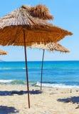 Straw Beach Umbrellas stock foto's