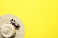 Straw Beach Woman`s Hat Top View Yellow Background. Straw Beach Woman`s Hat Sun Glasses Top View Yellow Background Flat Single Stock Image