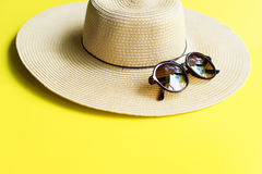 Straw Beach Woman`s Hat Top View Yellow Background Royalty Free Stock Photography