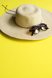 Straw Beach Woman`s Hat Top View Yellow Background Royalty Free Stock Images