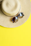 Straw Beach Woman`s Hat Top View Yellow Background Stock Image