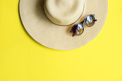 Straw Beach Woman`s Hat Top View Yellow Background. Straw Beach Woman`s Hat Sun Glasses Top View Yellow Background Flat Single Stock Photo