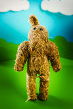 Straw bear on a green spring background Royalty Free Stock Photo