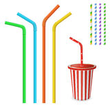 Straw for beverage. Striped and colorful straws. Drinking straws isolated on a white background. Plastic fastfood cup for beverage Royalty Free Stock Photography