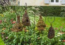 Straw birdhouses are suspended stock image