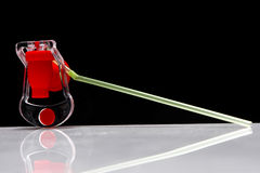 Straw on a black background. Colorful drinking straw and a fizz keeper against a black background Stock Photo