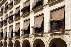 Straw Blinds over Windows in Spain Royalty Free Stock Images