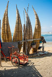 Straw boats still used by local fishermens in Peru Stock Photos