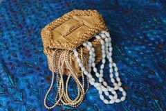Straw box for jewelry with beads royalty free stock photography