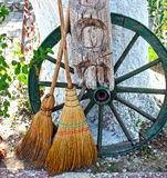 Straw broom with wooden wheel Stock Photos