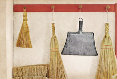Straw brooms Stock Photos