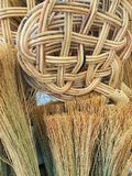 Straw Brooms and Cane Basket Royalty Free Stock Images