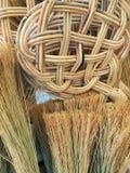 Straw Brooms y Cane Basket Imágenes de archivo libres de regalías