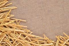 Straw on burlap Royalty Free Stock Photos