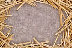 Straw on burlap royalty free stock photography