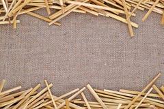 Straw on burlap Stock Images