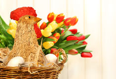 Straw chicken in wicker basket Royalty Free Stock Photo